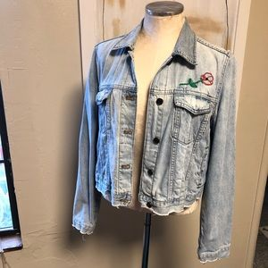 Light wash jean jacket with embroidered flower